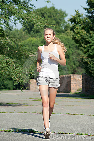 Girl jogging in summer park