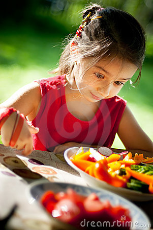 Girl joyfully is surprised to tasty vegetables