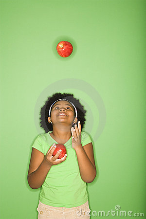 Free Girl Juggling Apples. Royalty Free Stock Photography - 3423287