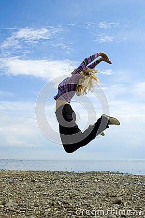 Girl jump above Baltic sea