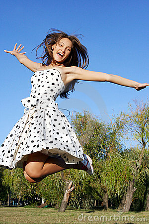 Free Girl Jumping Against Blue Sky Stock Images - 14728514