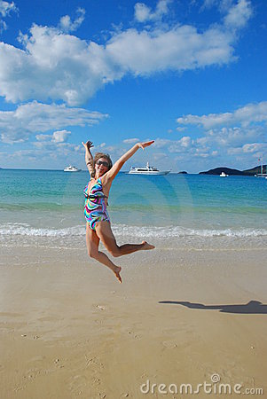 Girl jumping on the beach