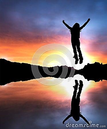 Girl jumping at dusk