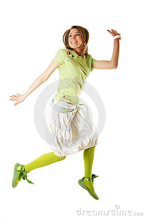 Girl jumping of joy over white