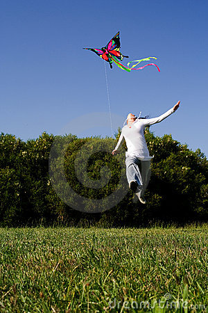 Girl jumping with Kite