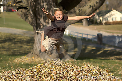 Girl Jumping into Leaf Pile