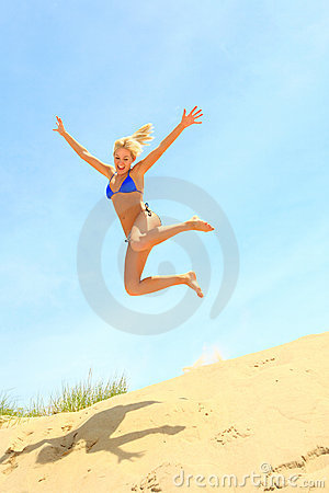 Free Girl Jumping Off A Sand Dune Stock Photo - 7565420