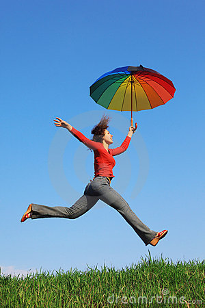 Free Girl Jumping Over Grass With Colorful Umbrella Royalty Free Stock Photos - 17889098