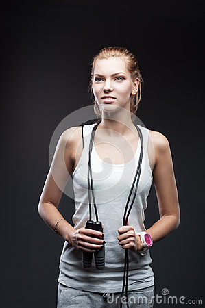 Girl with jumping-rope on dark background