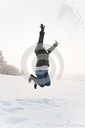 Girl jumping at snow