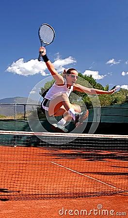 Girl jumping tennis net