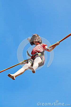 Girl jumps on bungee cord