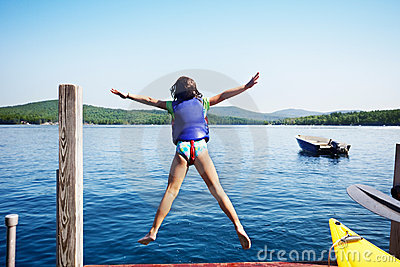 Girl jumps in the lake