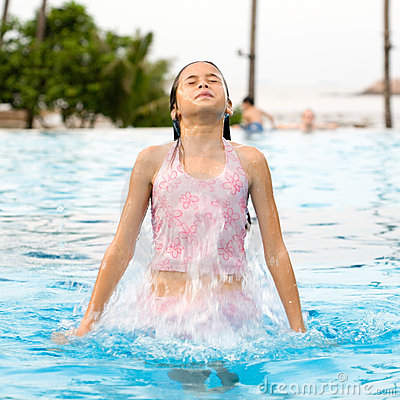 Girl jumps out from the swimming pool