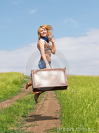 Girl jumps with a suitcase