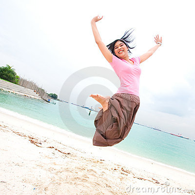 girl jumps up high in the air