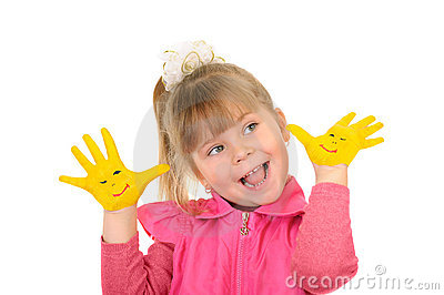Girl keeps hands which are painted in yellow color