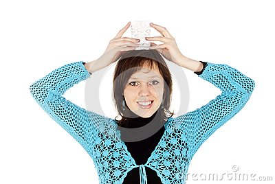 Girl keeps on her head a glass of water