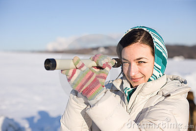 Girl in kerchief take a look in spyglass on field