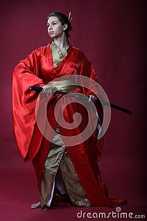 Girl in a kimono with a katana