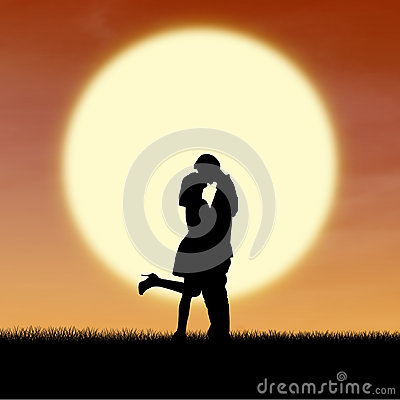Girl kiss guy on valentine sunset silhouette