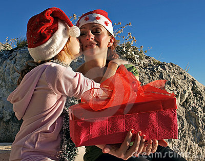 Girl kiss mother with Christmas gift