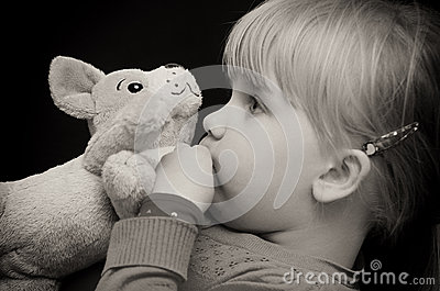 Girl kiss toy bear