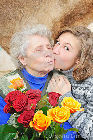 Girl kissed grandmother