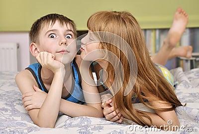 Girl kissing boy on cheek