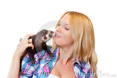 Girl kissing a ferret