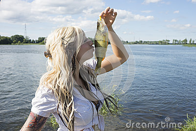 Girl kissing fish