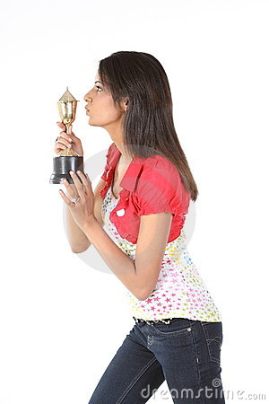 Girl kissing her gold trophy