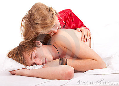 Girl kissing sleeping boyfriend