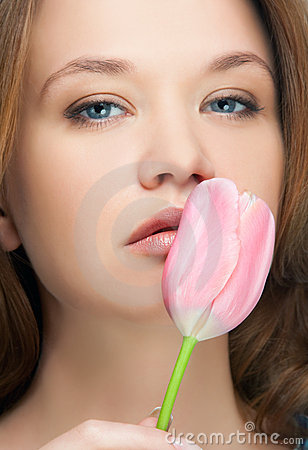 Girl kissing tulip portrait