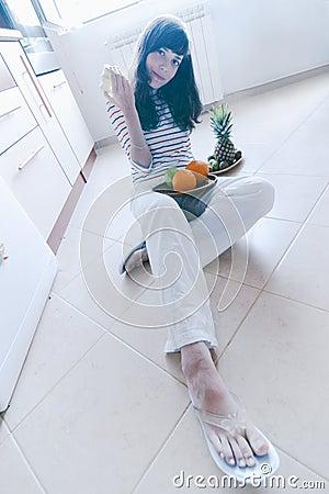 Girl on kitchen floor
