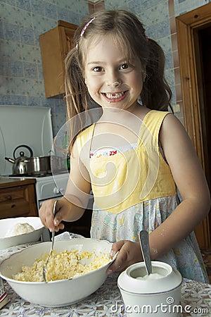 Girl kneads dough