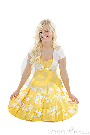 Girl kneeling in yellow dress