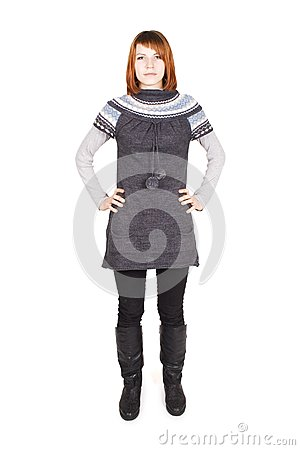 Girl in knit dress standing, hands on hips