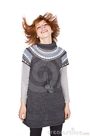 Girl in knit dress wave her head, hair in motion