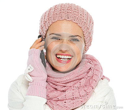 Girl in knit winter clothing making phone call