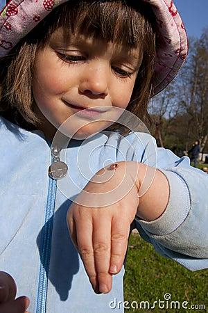 Girl with ladybug
