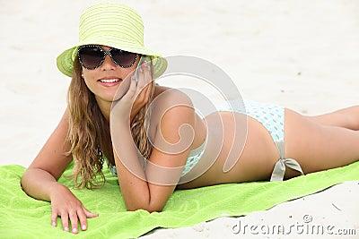 Girl laid on beach towel