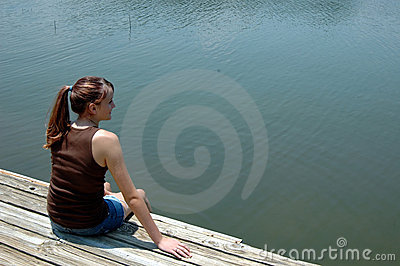 Girl at lake on dock