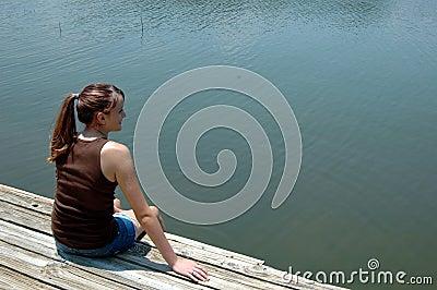 Girl at lake on dock