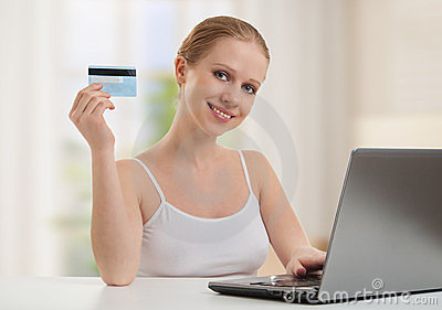 Girl with laptop makes payment online cards