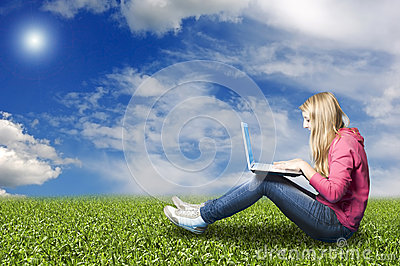 Girl with laptop in nature