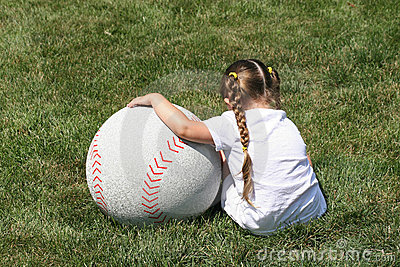 Girl and Large Baseball