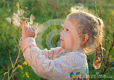 Girl with a large dandelion