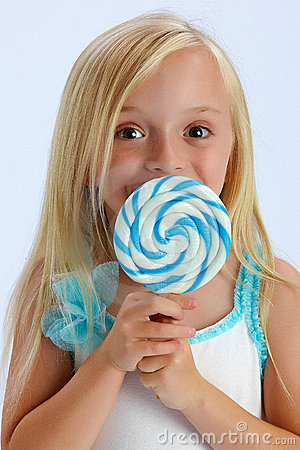 Girl with large lollipop