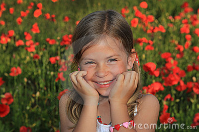 Girl laughing in a poppy field